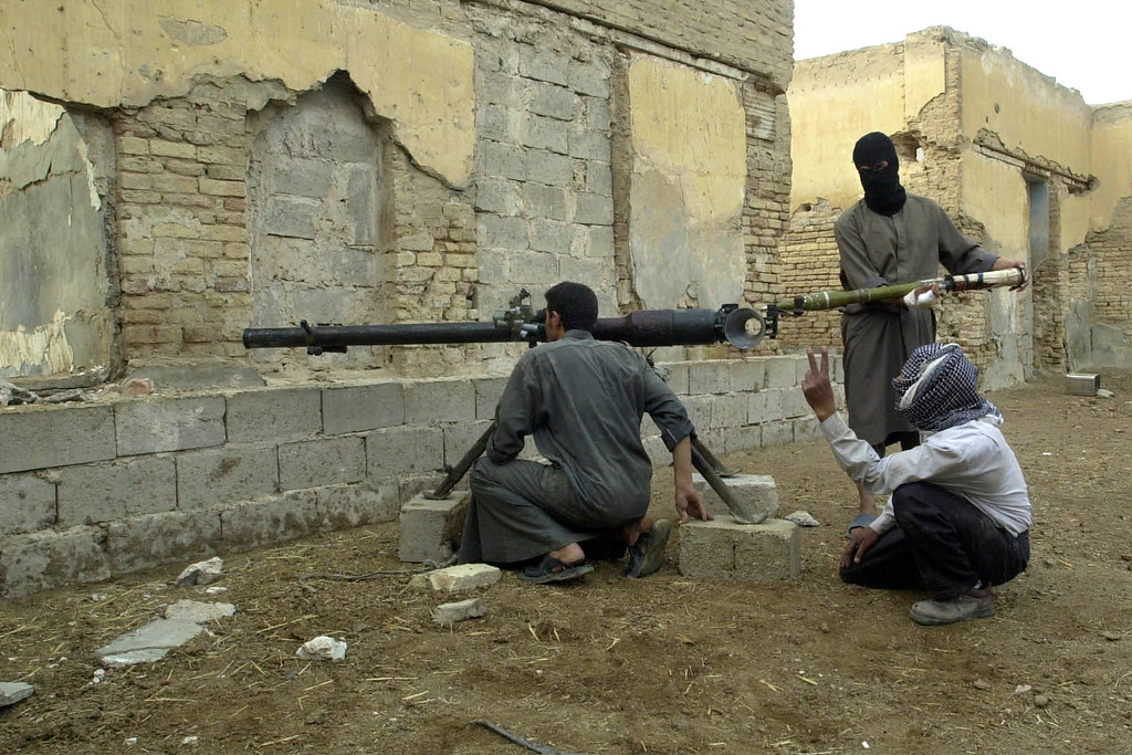 . Insurgents load a rocket-propelled grenade into a launch tube during an attack on U.S. forces in Fallujah, Iraq, Monday, Nov. 8, 2004. (AP Photo/Bilal Hussein)