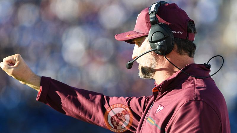 Virginia Tech defensive coordinator Bud Foster signals in a play. (Michael Shroyer/TheKeyPlay.com)