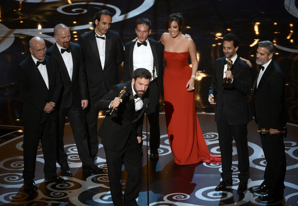 "Description of . Actor/producer/director Ben Affleck accepts the Best Picture award for ""Argo"" along with members of the cast and crew onstage during the Oscars held at the Dolby Theatre on February 24, 2013 in Hollywood, California.  (Photo by Kevin Winter/Getty Images)"