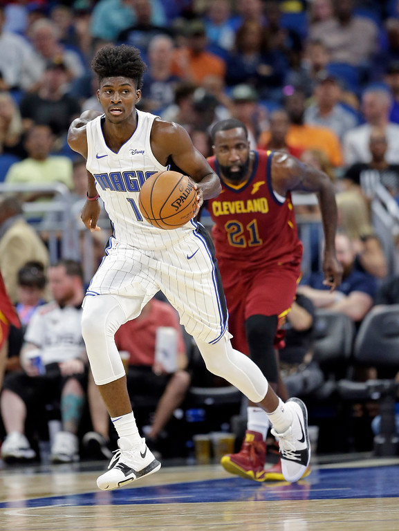 . Orlando Magic\'s Jonathan Isaac (1) moves the ball past Cleveland Cavaliers\' Kendrick Perkins (21) during the second half of an NBA preseason basketball game, Friday, Oct. 13, 2017, in Orlando, Fla. Cleveland won 113-106. (AP Photo/John Raoux)