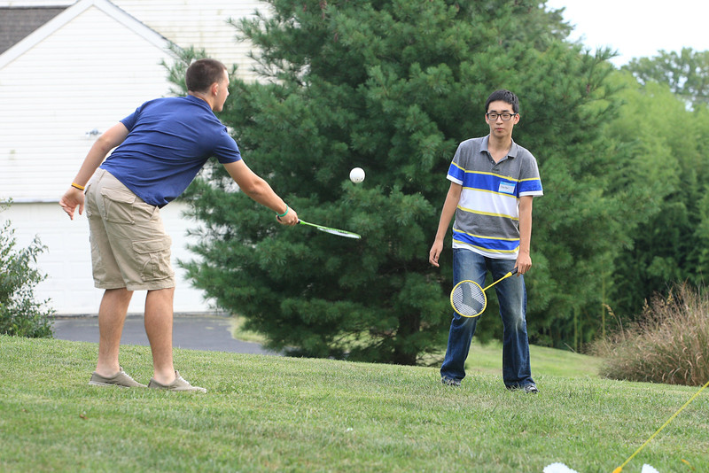 Chester Yang (right) an exchange student from China plays badminton with St. Elizabeth 12th grader David McTaggart during a picnic to introduce American students to Chinese students who will be studying at Padua and St. Elizabeth this year. photo/www.DonBlakePhotography.com