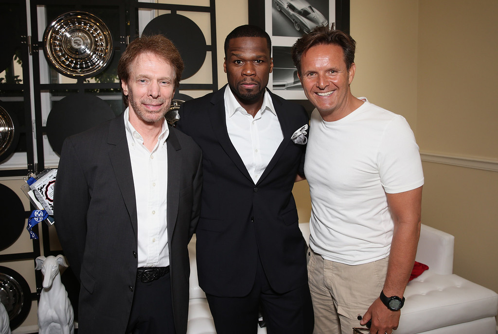 ". From left, Jerry Bruckheimer, Curtis ""50 Cent\"" Jackson and Mark Burnett attend the second day of the 2013 Produced by Conference on Sunday, June 9, 2013 in Los Angeles. (Photo by Todd Williamson/Invision for Producers Guild/AP Images)"