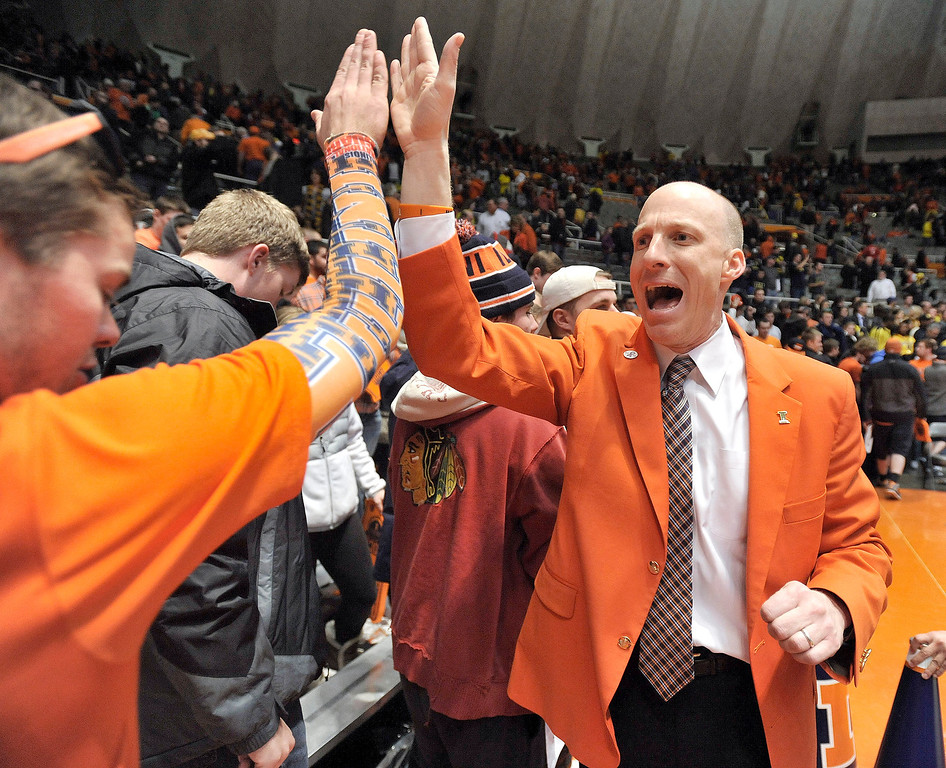 . Illinois coach John Groce greets student fans after Illinois\' NCAA college basketball game against Michigan on Tuesday March 4, 2014, in Champaign, Ill. Michigan won 84-53. (AP Photo/Rick Danzl)