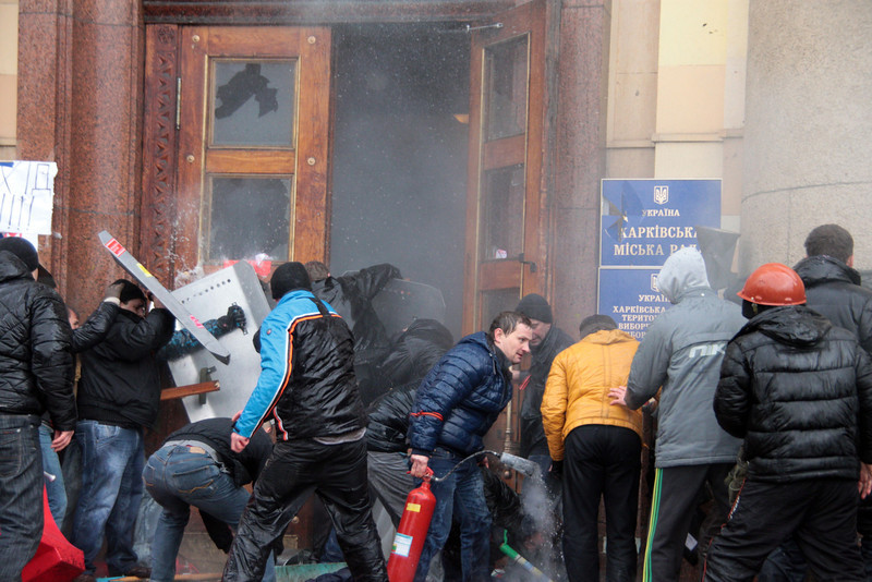 . Pro-Russian activists clash with Maidan supporters as they storm the regional government building in Kharkiv on March 1, 2014. Dozens were hurt on March 1, 2014 when a pro-Russia protest in Ukraine\'s eastern city of Kharkiv turned violent, with demonstrators trying to storm the local government building, an AFP reporter said. Some 20,000 joined the protest against Kiev\'s new pro-West government after the ouster of Kremlin-backed leader Viktor Yanukovych, and later around 300 launched the assault on the government building. Stones and stun grenades were thrown though it was unclear by whom.  (SERGEY BOBOK/AFP/Getty Images)