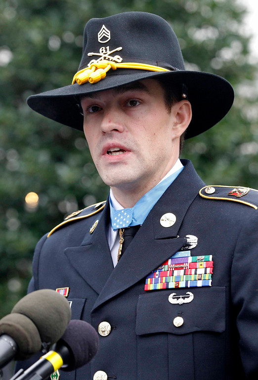 . The Medal of Honor is pictured around the neck of former active duty Army Staff Sergeant Clinton Romesha following a ceremony where he was presented with the medal by U.S. President Barack Obama at the White House in Washington, February 11, 2013.  REUTERS/Jason Reed