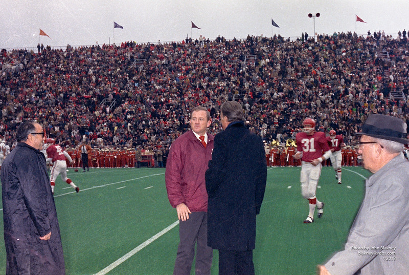 Jimmy Karam watches Arkansas Coach Frank Broyles have a few words with Billy Graham. Dr. W. O. Vaught at far right.