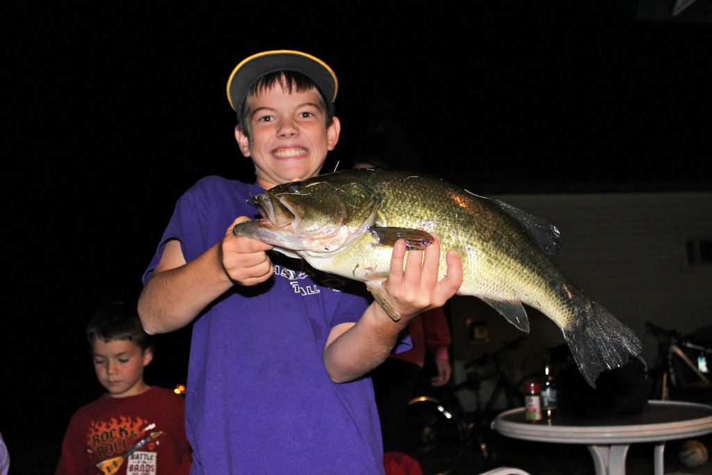 """. Brophy trophy: Cole Backer, 12, of New Ulm, pulled in this dandy bass from Brophy Lake near Alexandria earlier this spring. Cole\'s story: \""""My family and I were at Lake Brophy when I caught this trophy size largemouth bass while fishing off the resort bridge using a live frog for bait.  We measured his length at 21.5 inches, just 2 inches short of the Minnesota State record.  After measuring, I put him back in the lake.  There�s still a trophy in Brophy Lake.\"""" (Photo courtesy Dan Backer)"""