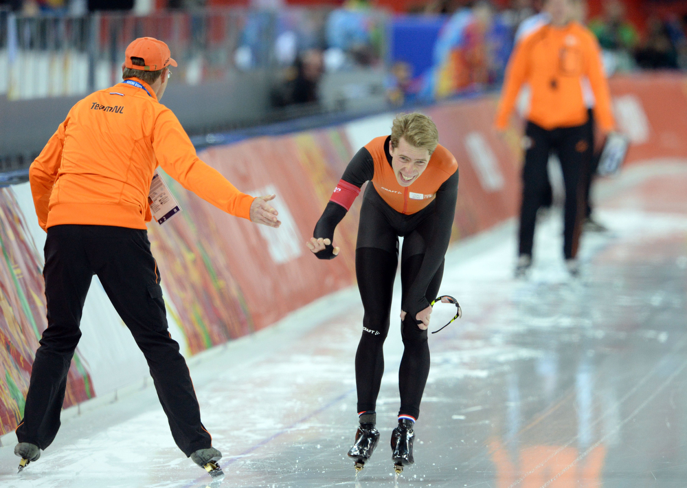 . Netherlands\' Jorrit Bergsma celebrates with his coach after competing in the Men\'s Speed Skating 10000 m at the Adler Arena during the Sochi Winter Olympics on February 18, 2014. (YURI KADOBNOV/AFP/Getty Images)