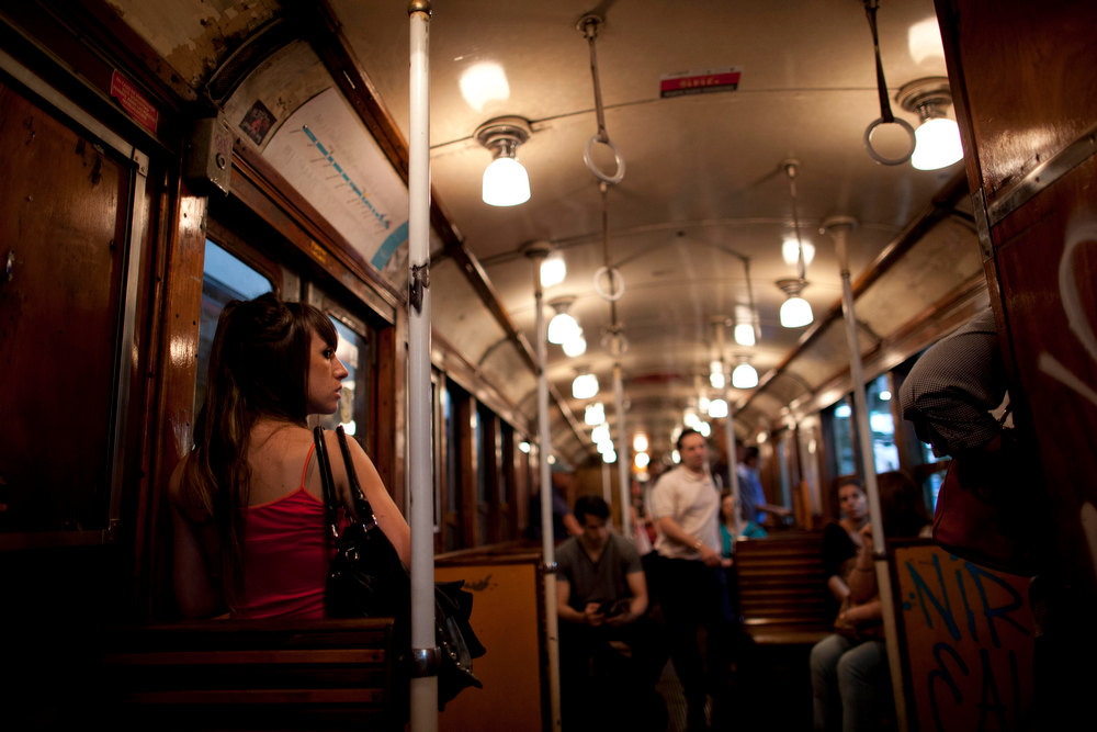 ". Commuters travel in a wooden carriage car on the historic subway system, Line A, in Buenos Aires, Argentina, Wednesday, Jan. 2, 2013. The city government announced that the almost 100-year-old \'La Brugeoise""wooden carriages will be replaced in a short time by modern Chinese units. (AP Photo/Natacha Pisarenko)"