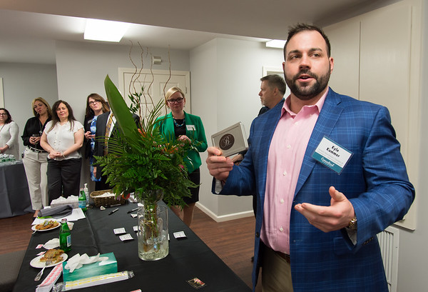 04/09/19 Wesley Bunnell | Staff New Britain Memorial - Sagariino Funeral Home hosted an after hours event on Tuesday evening for the New Britain Chamber of Commerce members. NB Chamber Interim President Kyle Kummer raffles off a gift certificate for Belvedere's Restaurant.