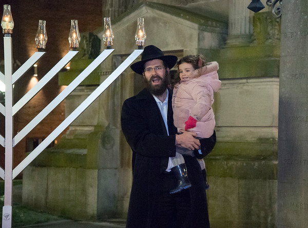 12/26/19 Wesley Bunnell | StaffrrRabbi Yosef Rivkin, holds his daughter Chana, age 3, after a Menorah lighting in Central Park on Thursday December 26, 2019.
