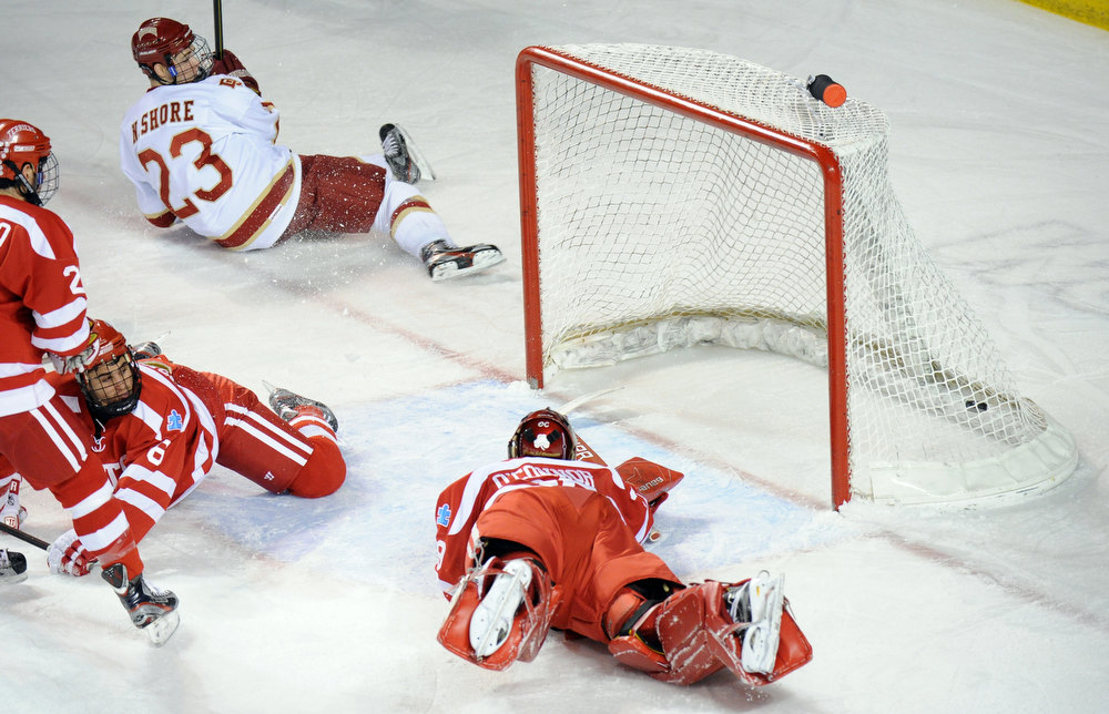 . University of Denver\'s Nick Shore (23), top, scores goal on Boston University goalie Matt O\'Connor (29), bottom, in the 2nd period of the game at Magness Arena in Denver, Colo. on Saturday, December 29, 2012. Hyoung Chang, The Denver Post