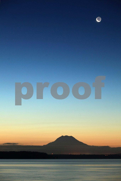 Sunrise and over Mt. Rainier as seen from Puget Marina near Olympia, WA.