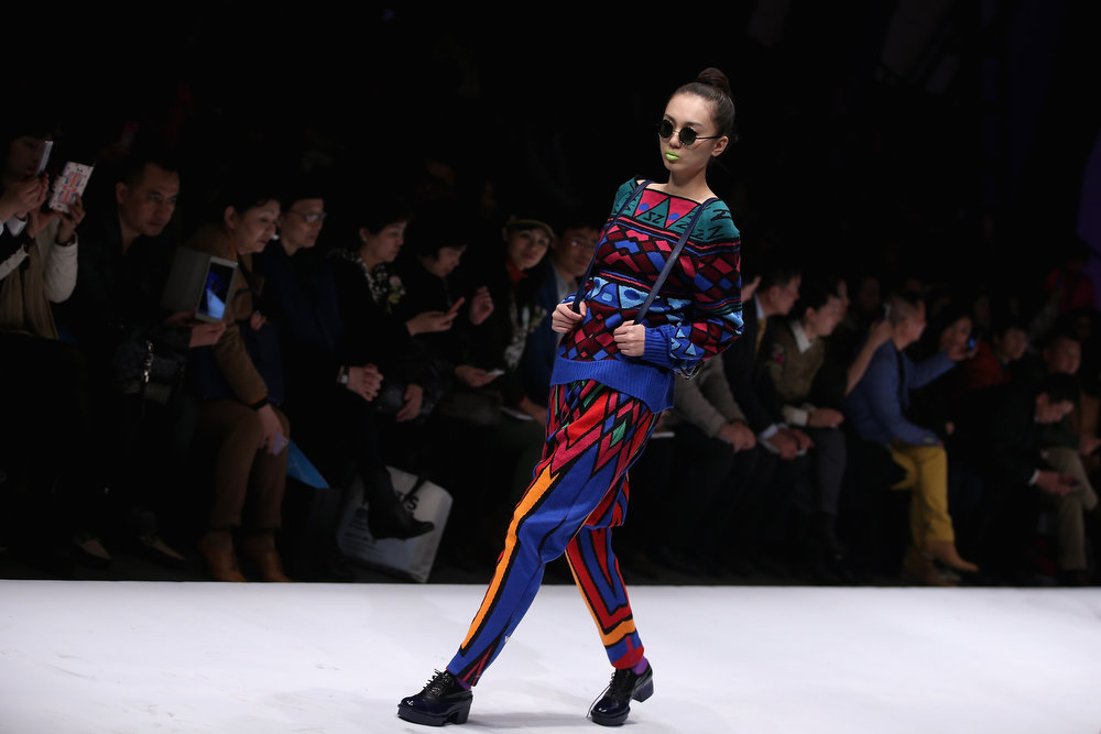 . A model showcases designs on the catwalk during WSM China Knitwear Fashion Design Contest 2013 on the third day of Mercedes-Benz China Fashion Week Autumn/Winter 2013/2014  at 751 D.PARK Central Hall on March 26, 2013 in Beijing, China.  (Photo by Feng Li/Getty Images)