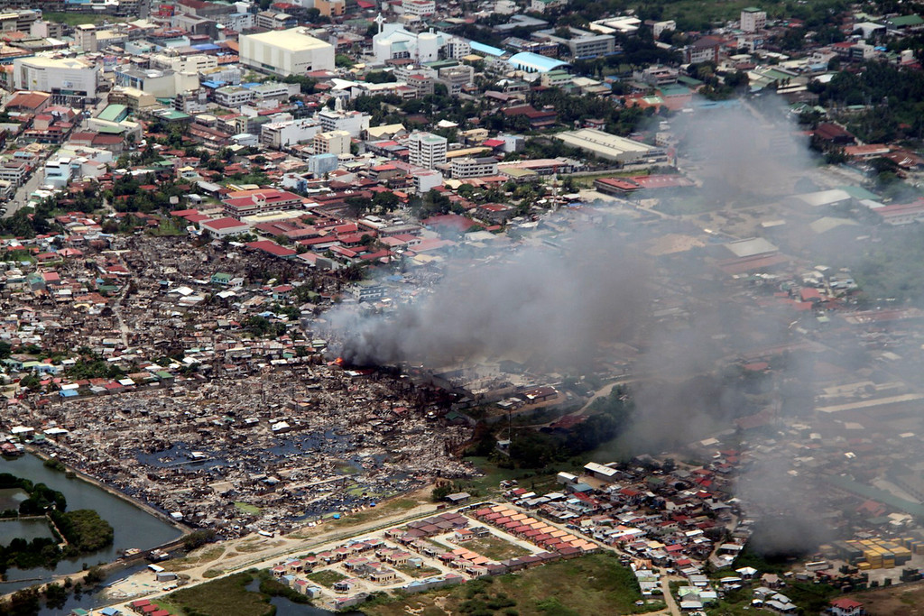 . In this Tuesday, Sept. 17, 2013 photo released by the Philippine Air Force, a fire breaks out at a village in Zamboanga city where government troops battle a holdout group of Muslim rebels holding hostages in southern Philippines. It was the most serious fighting in years between rebels and government forces in the predominantly Roman Catholic nation\'s south, the scene of decades-old struggle for self-rule by minority Muslims. (AP Photo/Philippine Air Force)