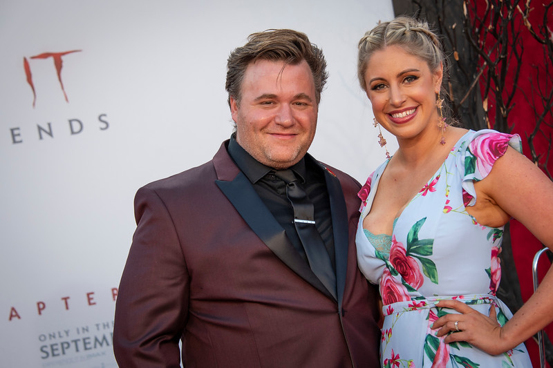 """WESTWOOD, CA - AUGUST 26: Benjamin Wallfisch and wife Missy Wallfisch attend the Premiere Of Warner Bros. Pictures' """"It Chapter Two"""" at Regency Village Theatre on Monday, August 26, 2019 in Westwood, California. (Photo by Tom Sorensen/Moovieboy Pictures)"""