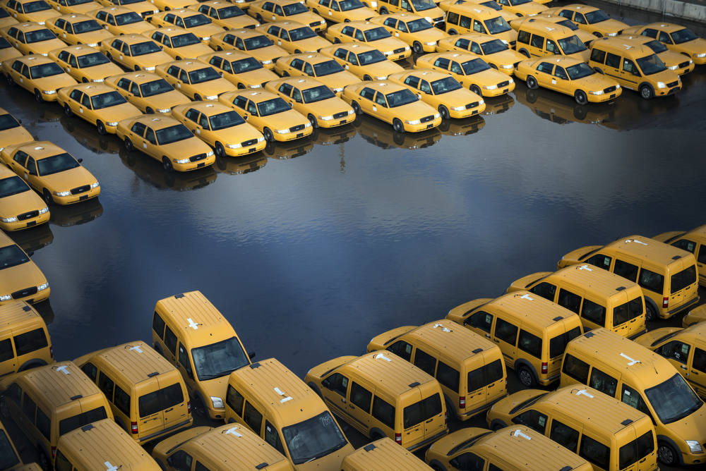 Description of . New taxi cabs are seen in a lot as flood waters recede on October 31, 2012 in Hoboken, New Jersey.  Hurricane Sandy which made landfall along the New Jersey shore, has left parts of the state and the surrounding area flooded and without power. AFP PHOTO/Brendan  SMIALOWSKI/AFP/Getty Images