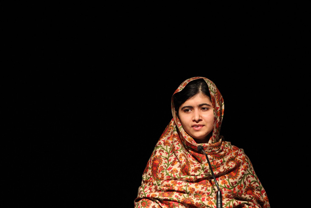 . In this photograph taken on September 17, 2013 Pakistani student who was shot in the head by the Pakistani Taliban, Malala Yousafzai addresses the assembly before receiving the Amnesty International Ambassador of Conscience Award for 2013 at the Manison House in Dublin, Ireland.AFP PHOTO/ PETER MUHLY //AFP/Getty Images
