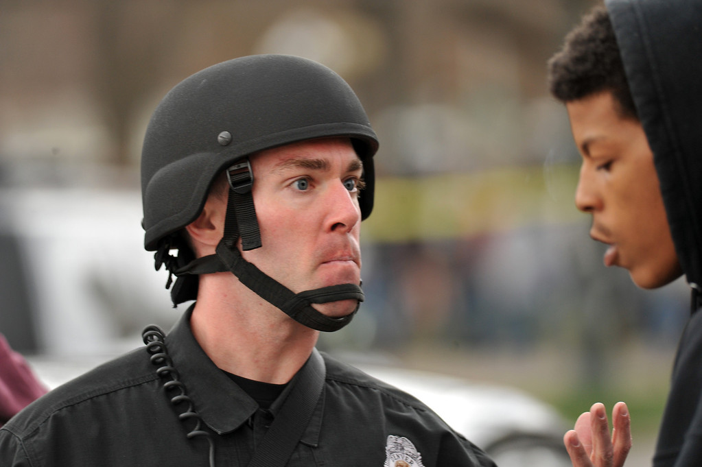 . DENVER, CO. - APRIL 20 : A Denver Police officer secures the shooting site. Two people were shot in Denver\'s Civic Center during Saturday\'s pot rally, according to paramedics on the scene. Denver, Colorado. April 20, 2013. (Photo By Hyoung Chang/The Denver Post)