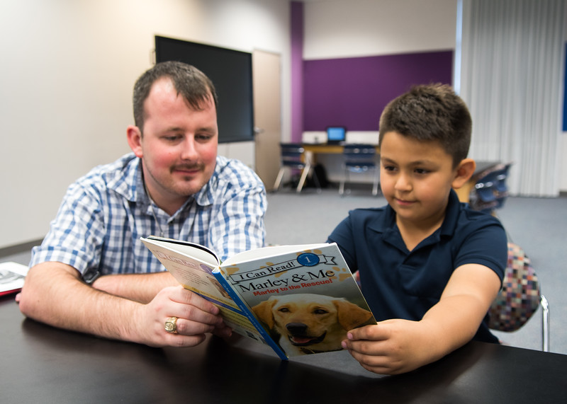 """Hunter Dismuke Reads Red Rocket Readers """"Marley & Me"""" with student Aaron Angel"""