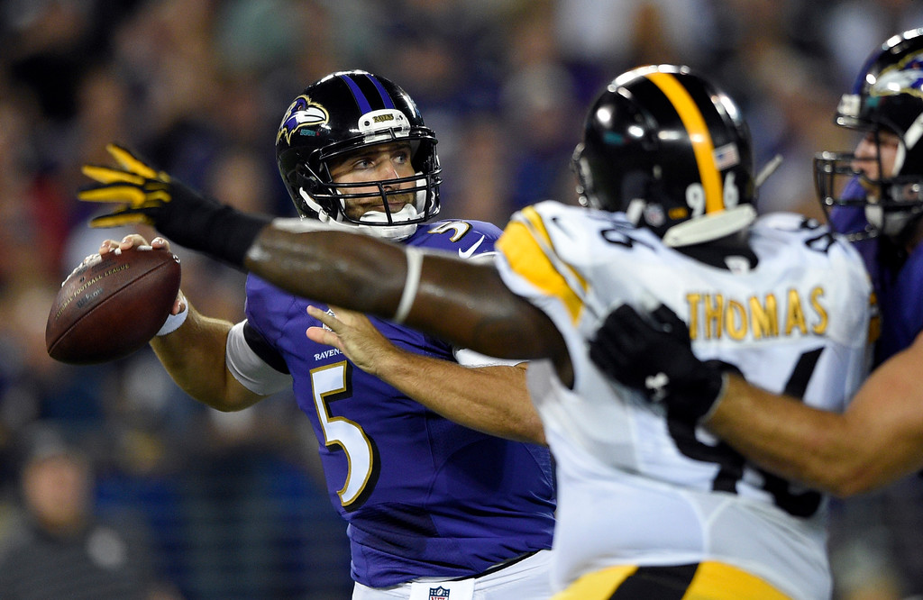 . Baltimore Ravens quarterback Joe Flacco (5) looks to pass under pressure from Pittsburgh Steelers nose tackle Cam Thomas (96) during the first half of an NFL football game Thursday, Sept. 11, 2014, in Baltimore. (AP Photo/Nick Wass)
