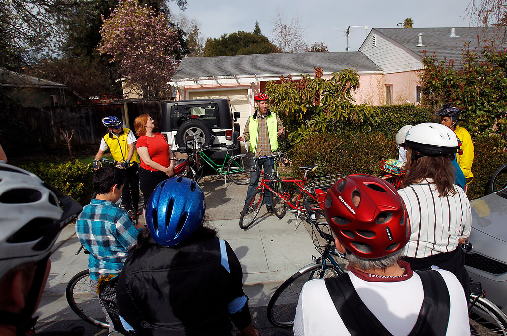 . At center, Stanford University graduate student Ariel Mendez talks about safety and his bike commuting experience to Stanford during the Great Streets Rengstorff Park Neighbor Bike Tour in Mountain View, Calif. on Sat., March 2, 2013. (LiPo Ching/Staff)