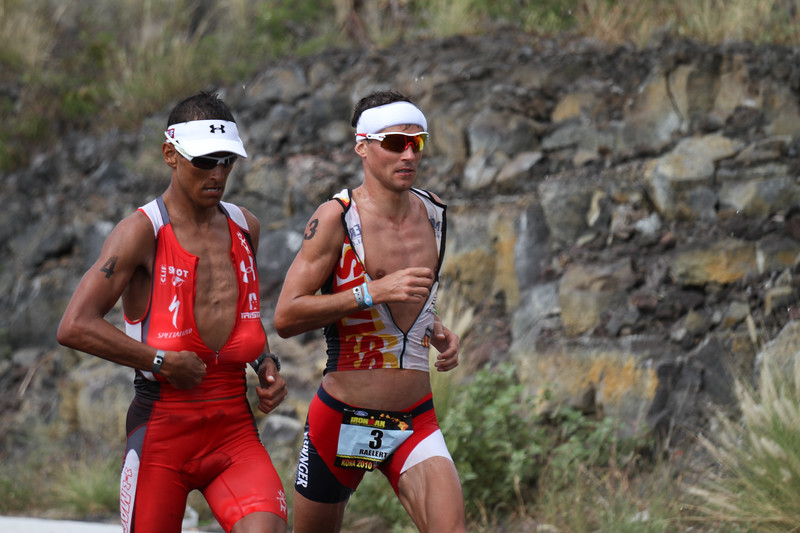Andreas Raelert & Chris McCormack at Mile 25; they have been seconds apart all day long.  Chris ends up wining it by about a minute and a half.
