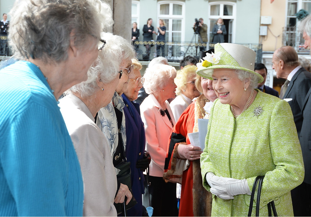 . Queen Elizabeth II talks to local women who are all aged in their nineties during her 90th Birthday Walkabout on April 21, 2016 in Windsor, England. Today is Queen Elizabeth II\'s 90th Birthday. The Queen and Duke of Edinburgh will be carrying out engagements in Windsor.  (Photo by John Stillwell - WPA Pool/Getty Images)