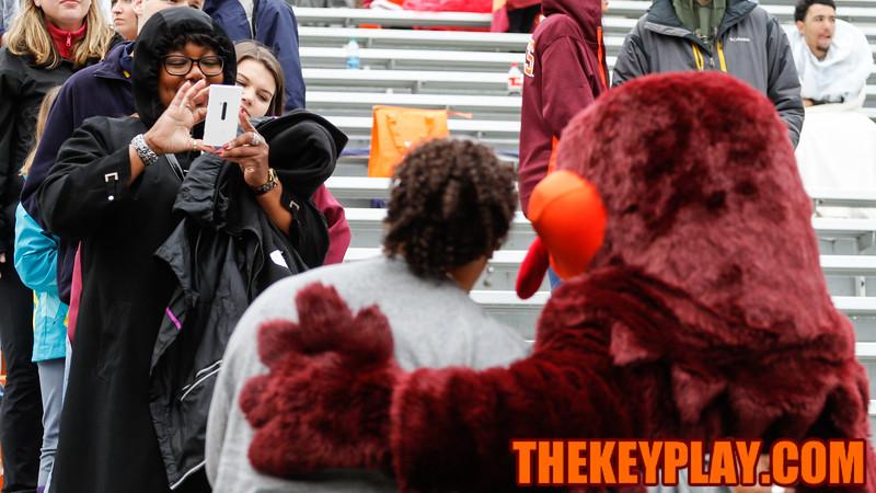 A fan gets a photo with the HokieBird in the South Stands. (Mark Umansky/TheKeyPlay.com)