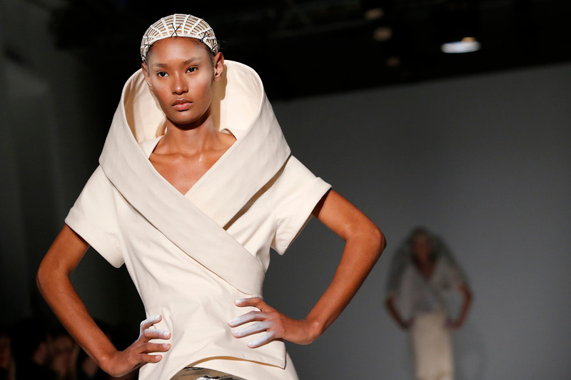 . A model presents a creation as part of British fashion designer Gareth Pugh\'s ready-to-wear fall/winter 2014-2015 fashion collection presented in Paris, Wednesday, Feb.26, 2014. (AP Photo/Jacques Brinon)