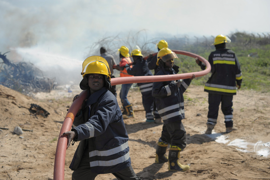 . AMISOM firefighters attempt to stop the fire at the site of an airplane crash in Mogadishu,  on August 9, 2013. An Ethiopian Air Force aircraft crashed upon landing this morning at Mogadishu\'s Aden Adde International Airport. AFP PHOTO/AU UN IST PHOTO / TOBIN  JONES/AFP/Getty Images