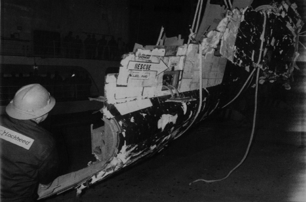Description of . Workmen off load the front section of the Space Shuttle Challenger Thursday night at Port Canaveral, Fla. This picture was released by Nasa Saturday a the Kennedy Space Center. 1986