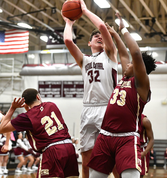 1/3/2020 Mike Orazzi   Staff Bristol Central High School's Donovan Clingan (32) and New Britain's Nyzaiah Diaz (21) and Dontay Bishop (33) during Friday night's boys basketball game in Bristol.