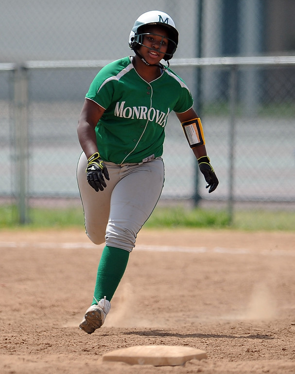 . Monrovia\'s Derek Blow doubles for a RBI in the third inning of the Northview Tournament championship softball game against Covina at Northview High School on Thursday, April 4, 2013 in Covina, Calif.  Monrovia won 6-0. 