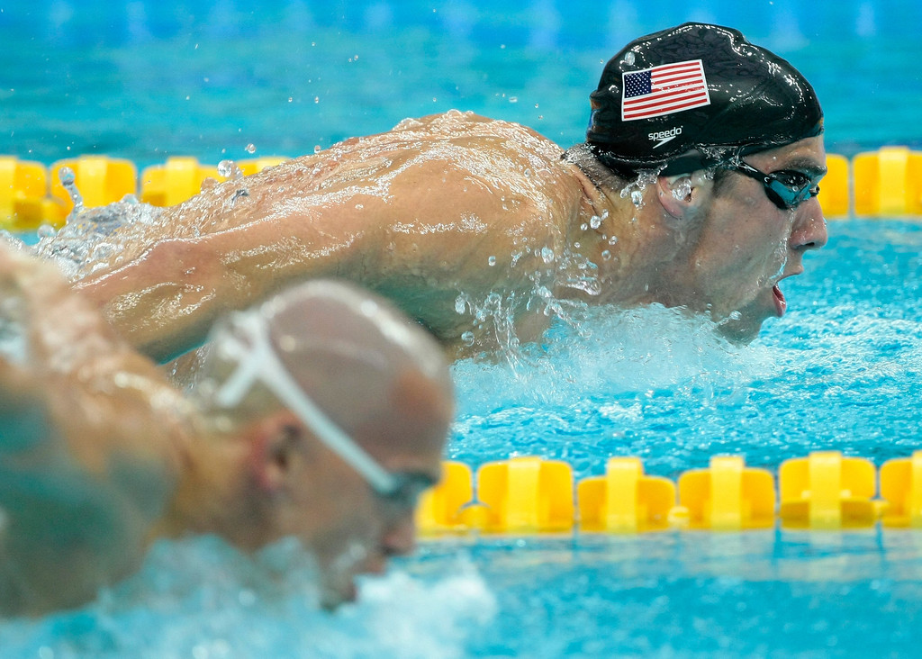 . United States\' Michael Phelps swims on his way to winning the gold medal in the men\'s 400-meter individual medley final during the swimming competitions in the National Aquatics Center at the Beijing 2008 Olympics in Beijing, Sunday, Aug. 10, 2008. Front is Hungary\'s Laszlo Cseh. (AP Photo/Itsuo Inouye)