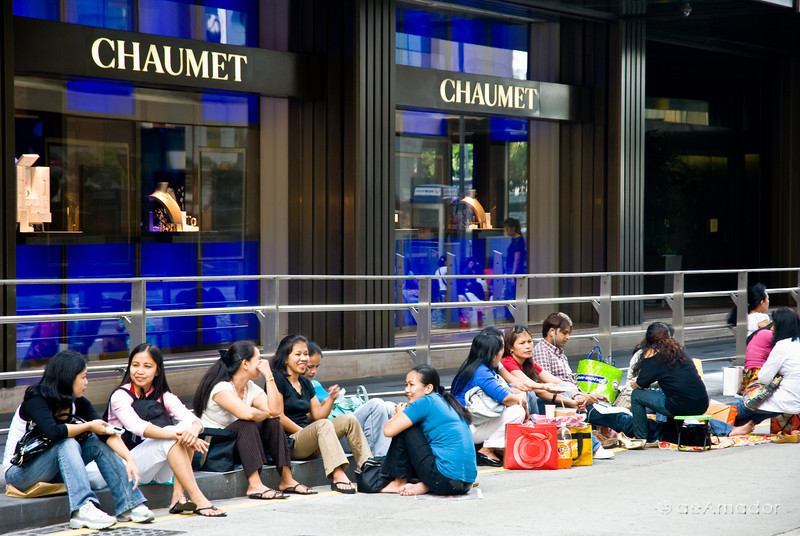 aeamador©-HK08_DSC0084  Hong Kong, downtown area, near ifc tower. I was very impressed by the affluence evidenced in this area. Hong Kong is quite a chic and fine place. These are Filipino maids that fill the entire downtown public spaces (sidewalks, streets and plazas) for picnicking. There are thousands of them, spread all over. No husbands, no men, no children. Just the women. Sunday is their day off.