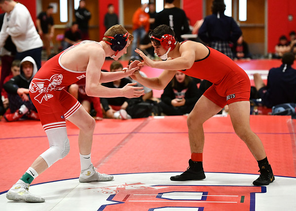 1/11/2020 Mike Orazzi | StaffrBerlin's Aidan O'Connor and Branford's A.J. Robinson while wrestling Saturday at Berlin High School.