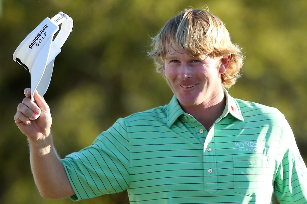 . AUGUSTA, GA - APRIL 13:  Brandt Snedeker of the United States waves to the crowd on the 18th green during the third round of the 2013 Masters Tournament at Augusta National Golf Club on April 13, 2013 in Augusta, Georgia.  (Photo by Andrew Redington/Getty Images)