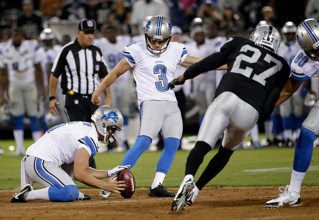 . Detroit Lions kicker Nate Freese (3) kicks a 55-yard field goal from the hold of Sam Martin during the second quarter of an NFL preseason football game against the Oakland Raiders in Oakland, Calif., Friday, Aug. 15, 2014. (AP Photo/Marcio Jose Sanchez)