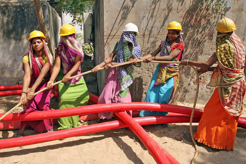 . Indian women laborers work to lay a cable for an electricity company on International Women\'s Day in Ahmadabad, India, Friday, March 8, 2013. (AP Photo/Ajit Solanki)