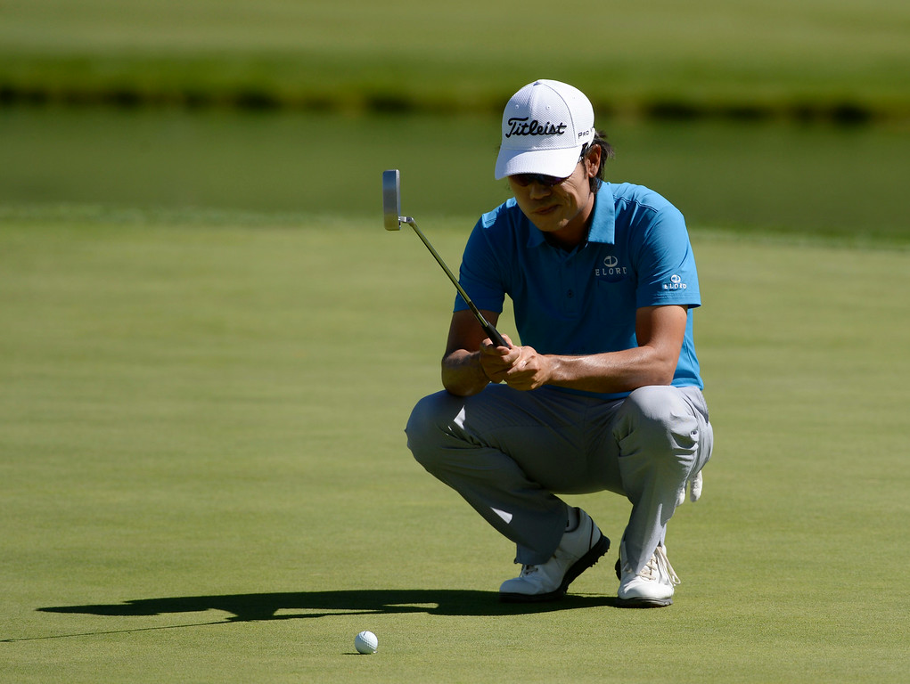 . CHERRY HILLS VILLAGE, CO. - SEPTEMBER 03:  Pro golfer, Kevin Na, looks over a putt on the 17th green, during the FedExCup BMW Championship Pro-Am at the Cherry Hills Country Club Wednesday, September 03, 2014. (Photo By Andy Cross / The Denver Post)