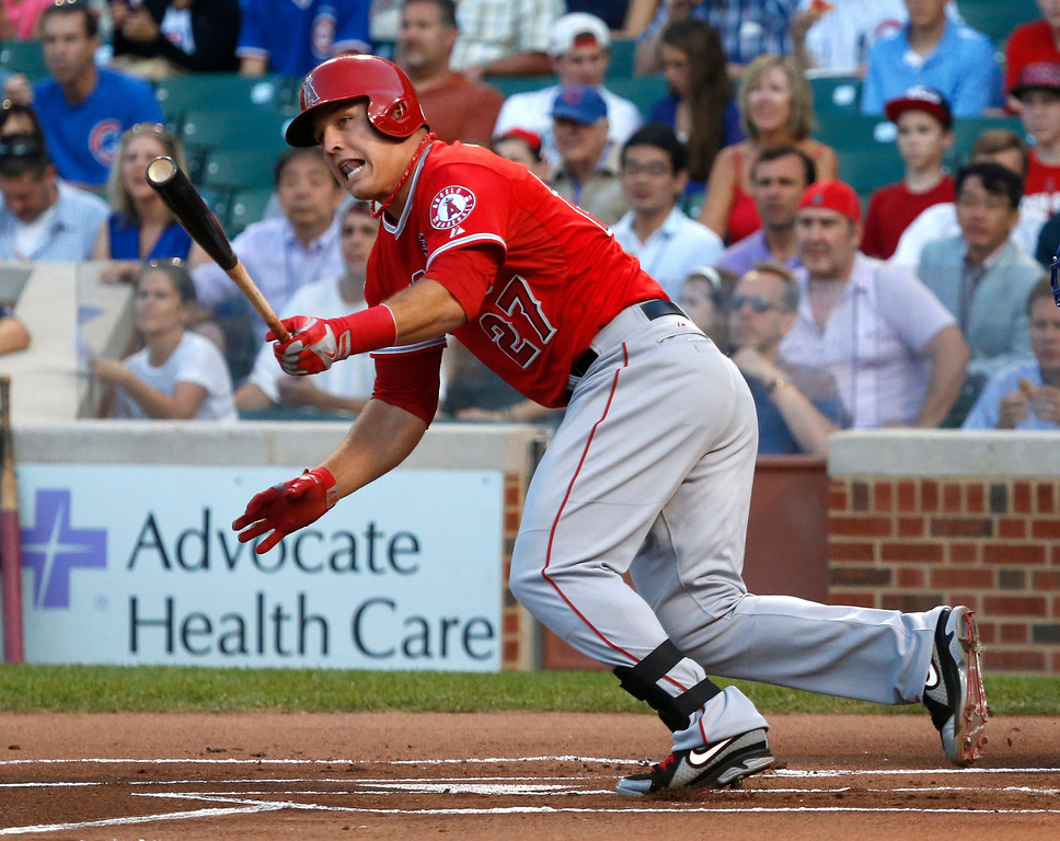 . Los Angeles Angels\' Mike Trout heads to first on an RBI double off Chicago Cubs starting pitcher Jeff Samardzija during the first inning of an interleague baseball game Wednesday, July 10, 2013, in Chicago. (AP Photo/Charles Rex Arbogast)