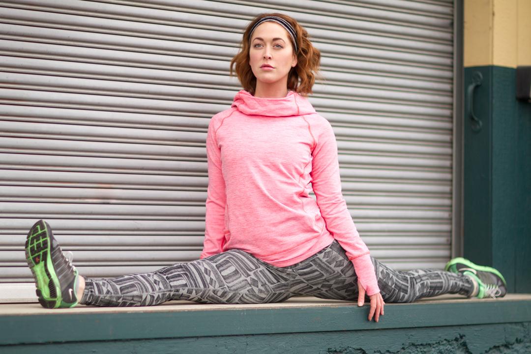 fitness model doing splits on a loading dock