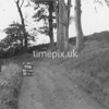 NJ910998B-LongView, Man marking Ordnance Survey minor control revision point with an arrow in 1950s