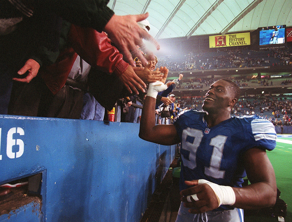 . Lions Robert Porcher slaps hands with fans after the Lions 15-10 victory over the Dallas Cowboys marking their last game at the Silverdome Sunday January 6, 2002.