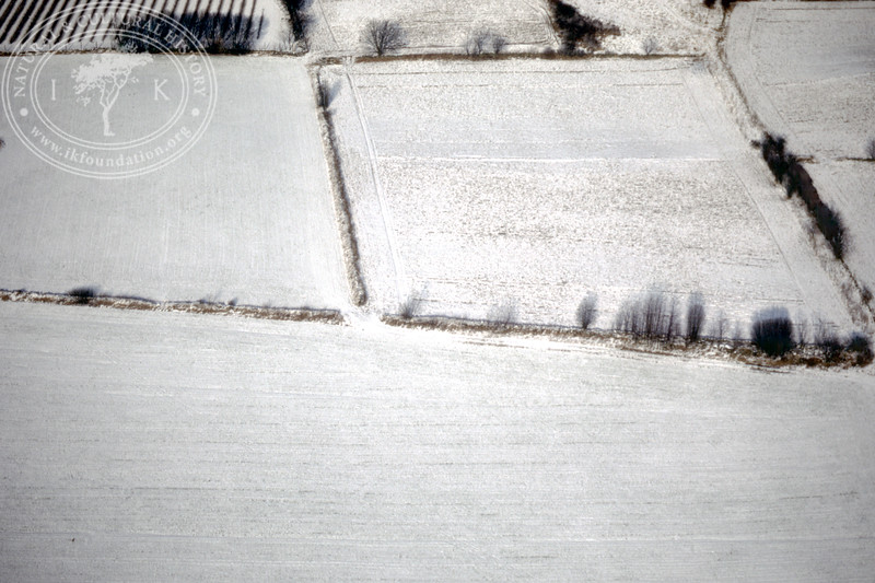 Farmland west of Ravlunda church - with plantations, buildings and prehistoric remains (20 February, 1988). | LH.0208