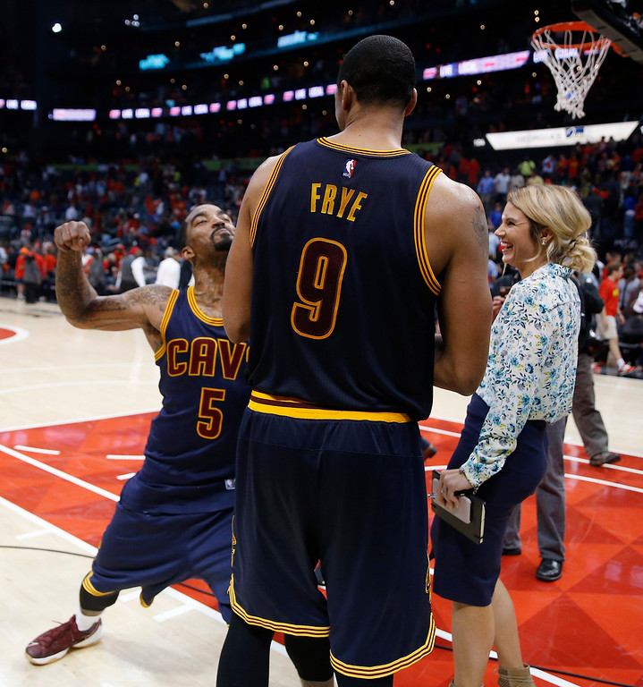 . Cleveland Cavaliers\' J.R. Smith (5) and  Channing Frye (9) celebrate their win over the Atlanta Hawks after the second half of Game 3 of the second-round NBA basketball playoff series, Friday, May 6, 2016, in Atlanta. Cleveland won 121-108 and leads the best-of-seven series 3-0. (AP Photo/John Bazemore)