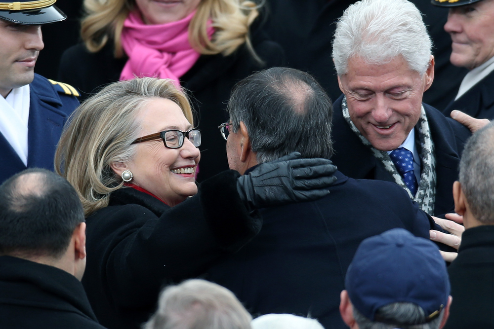 . U.S. Secretary of State Hillary Clinton greets Secretary of Defense Leon Panetta during the presidential inauguration on the West Front of the U.S. Capitol January 21, 2013 in Washington, DC.   Barack Obama was re-elected for a second term as President of the United States.  (Photo by John Moore/Getty Images)