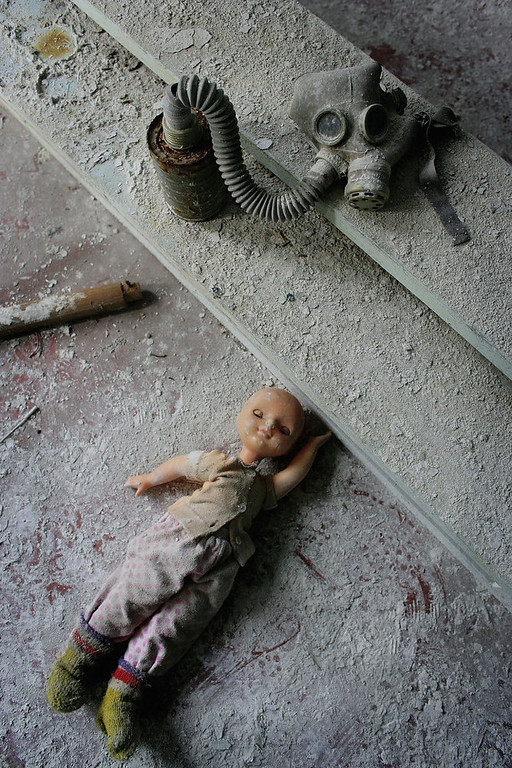 . Toys and a gas mask lay in dust, in an abandoned pre school in the deserted city of Pripyat on January 25, 2006 in Chernobyl, Ukraine. Prypyat and the surrounding area will not be safe for human habitation for several centuries. Scientists estimate that the most dangerous radioactive elements will take up to 900 years to decay sufficiently to render the area safe.  (Photo by Daniel Berehulak/Getty Images)
