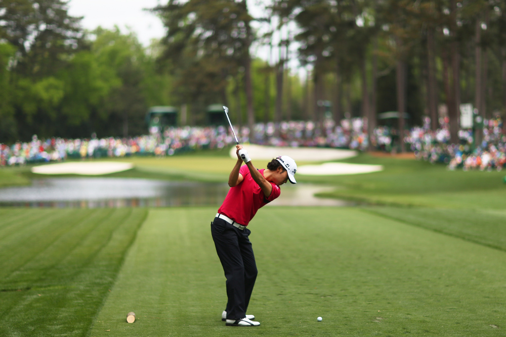 Description of . Kevin Na of the United States tees off on the 16th hole during the first round of the 2013 Masters Tournament at Augusta National Golf Club on April 11, 2013 in Augusta, Georgia.  (Photo by Mike Ehrmann/Getty Images)